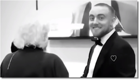 Mac Miller smiles in a tux