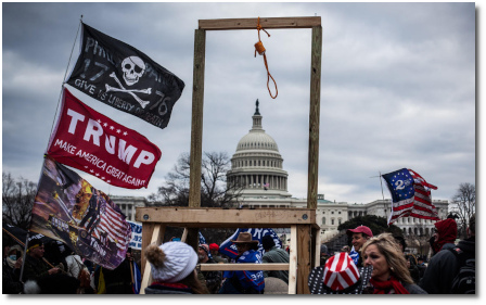 MAGA flag and Jolly Roger waving beside makeshift gallows, complete with hangman's noose and stairs leading up to the hanging platform, during the sacking and plunder of US Capitol by Trump supporters on 6 Jan 2021