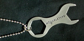 Movable Type Wrench Logo Sitting on Black Background